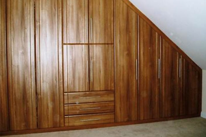Sloping wardrobes in natural wood